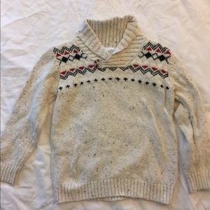 Cream, red and blue sweater.